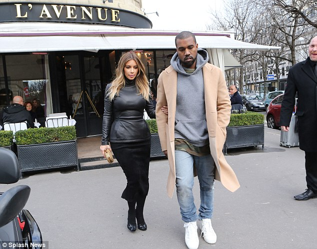 Two looks, one outing: Kim was dressed up in a black outfit while Kanye kept it much more casual in jeans and a hoodie