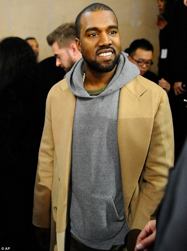 Look who's smiling now: The Gold Digger singer was later spotted at the Y-3 men's fall/winter fashion presentation