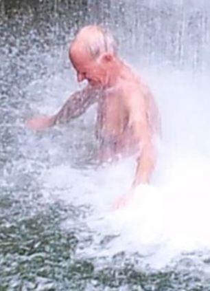 Shower: Mr Pratt at a waterfall on the island