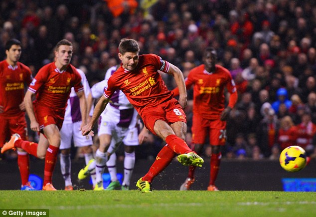 Spot on: Liverpool captain Steven Gerrard dispatches a penalty to share the points