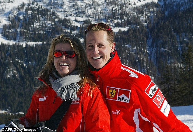 Michael Schumacher is being slowly brought out of his induced coma, his manager has said. His wife Corinna insists her husband is a 'fighter' who will not give up