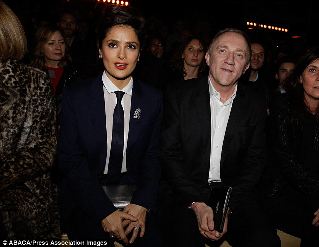 Glamorous: Salma Hayek and Francois-Henri Pinault front row at Yves Saint-Laurent's show