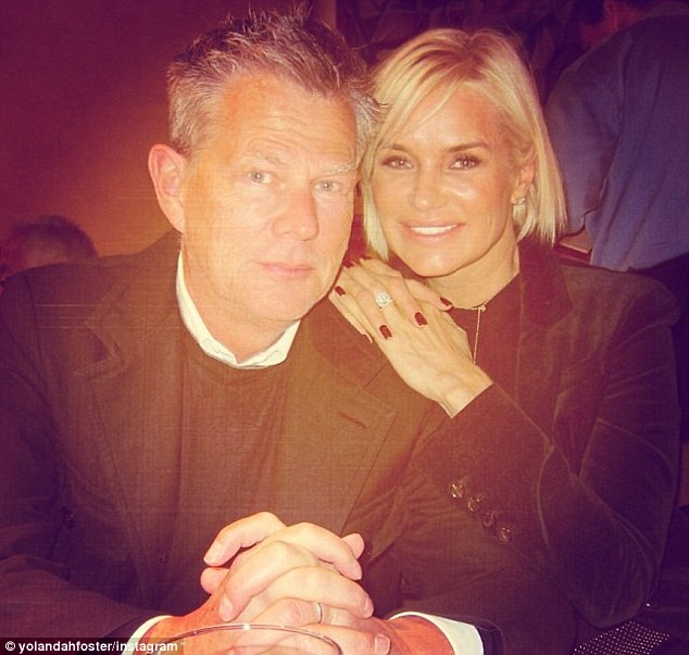 With her husband: Mrs Foster also posted a birthday photo with her husband - the acclaimed music producer David Foster (left)