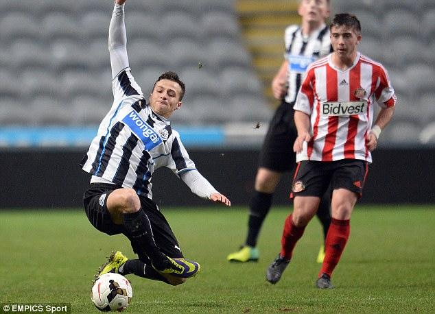 Time for lunge: Sunderland's Lynden Gooch (R) can only watch as Jamie Sterry of Newcastle intercets the ball