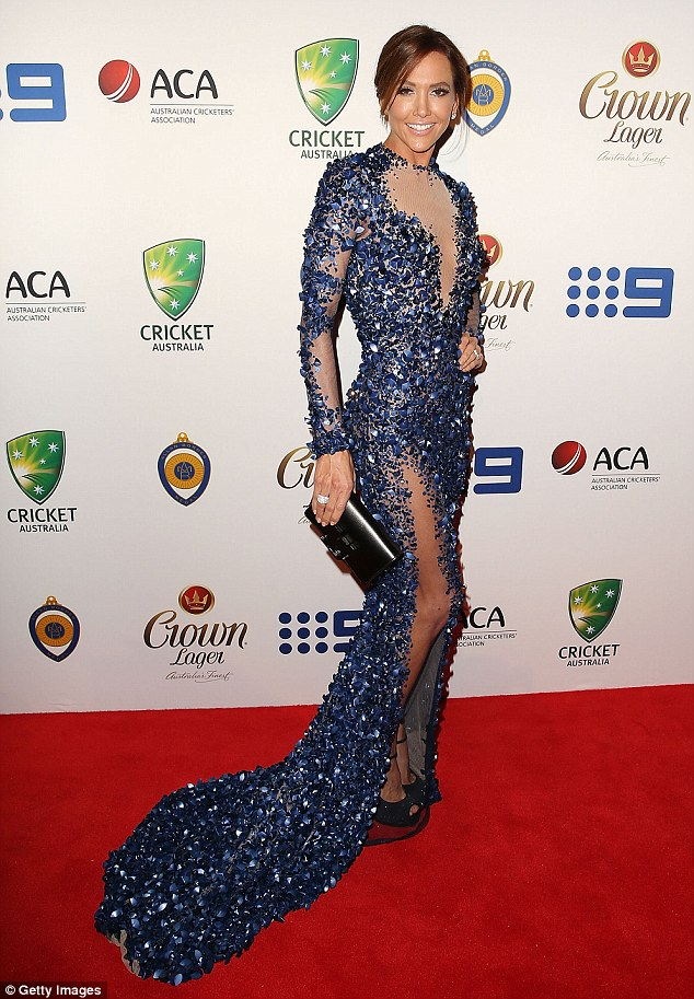 Sequin queen: Kyly Clarke arrived at Monday night's Allan Border Medal Awards ceremony at Doltone House, Sydney in a full-length, navy beaded dress