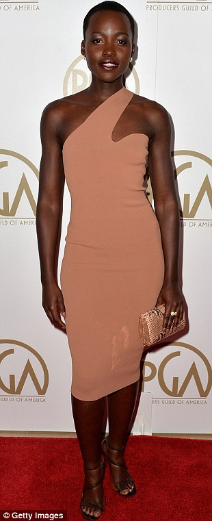 So stylish: Lupita Nyong'o looked typically stunning in a Stella McCartney biscuit coloured dress and black high heeled shoes