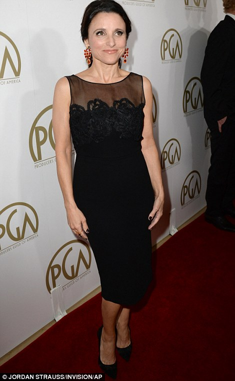 Back to black: Julia Louis-Dreyfus sported a knee-length black dress with lace detail and a chic low ponytail