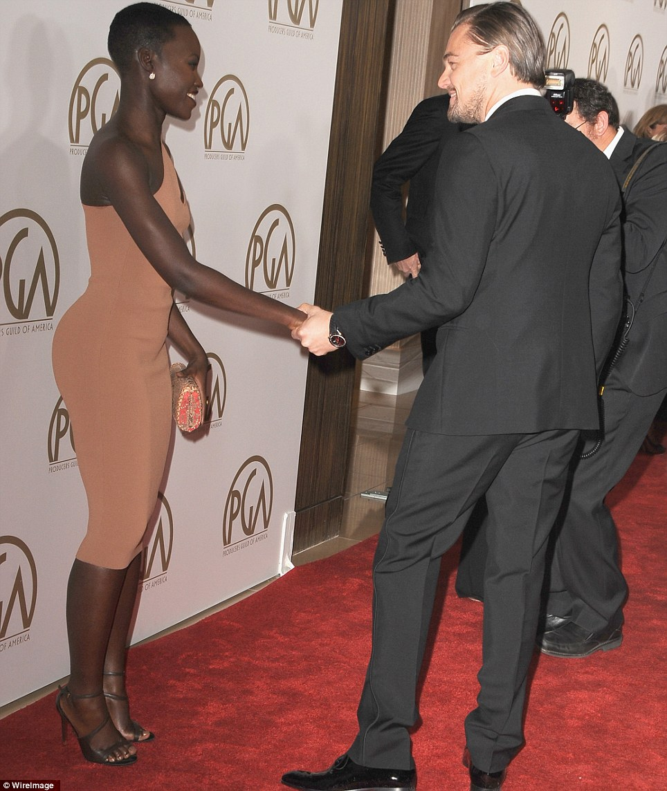 Pleased to meet you! Leonardo DiCaprio and Lupita shook hands on the red carpet as they continued to campaign for their movies during awards season