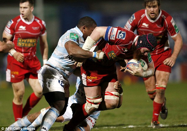 Second row: The Scarlets' Jake Ball (centre) powering through the Racing Metro defence
