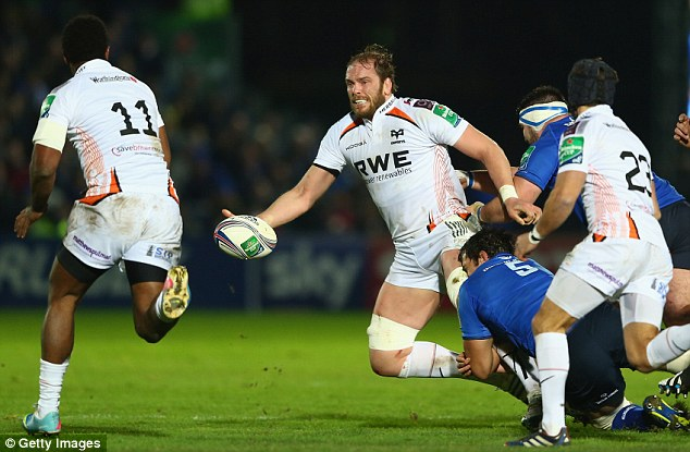 Offload: Alun Wyn Jones of the Ospreys (centre) may be playing against English teams next year
