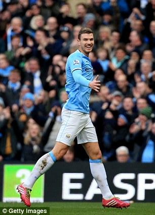 Art Dzeko: The Bosnia striker celebrates his goal against Cardiff