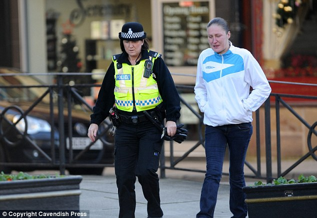 Emma Reeves (right) arriving at Chorley Magistrates Court. Reeves had perviously served three years jail after talking her way into the home of a couple before stealing £740