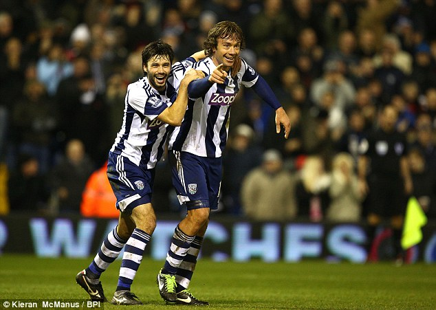 Equaliser: Diego Lugano of West Brom celebrates scoring the goal to make it 1-1 at the Hawthorns