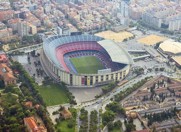 Impressive: The Nou Camp with the club's famous academy La Masia at bottom of picture