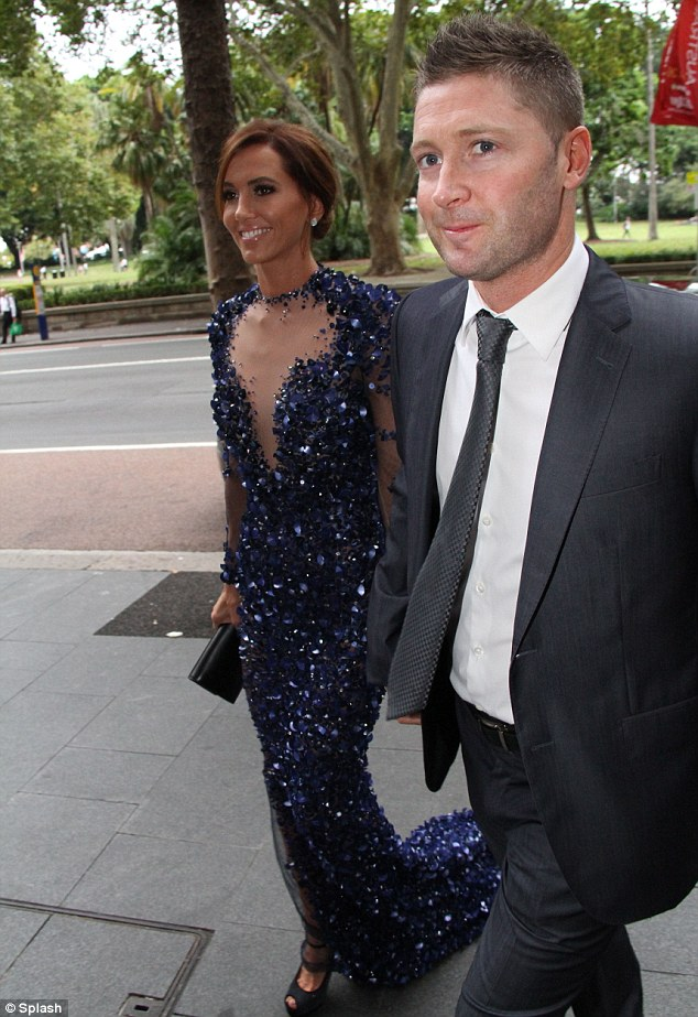 Celeb couple: Despite the drizzle, Kyly and her cricket captain Michael Clarke were all smiles as they arrived at the awards on Monday night