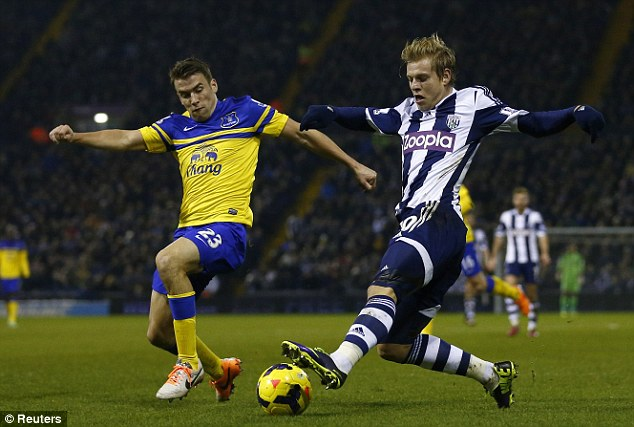Worry: Seamus Coleman (left) went off injured with what looked like a hamstring injury