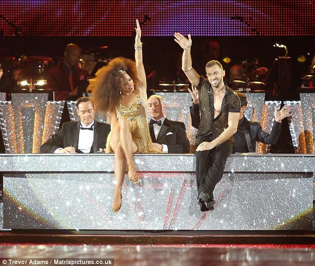 Hands in the air: Natalie Gumede and dance partner Artem Chigvintsev take to the dance floor
