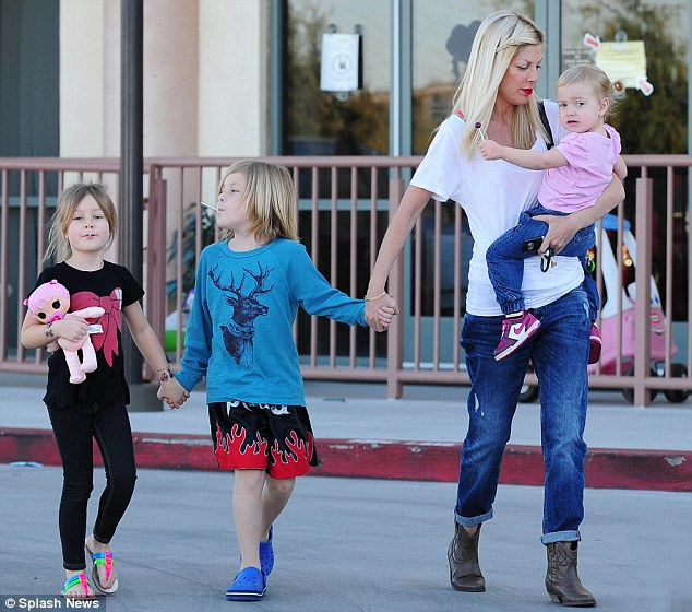 All together now: The McDermott family all held hands on a trip to the doctors in California