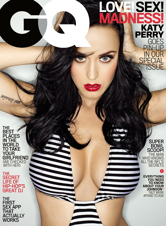 Stripping off: Katy poses in her striped bikini for the February edition of GQ, which hits newsstands everywhere on January 28