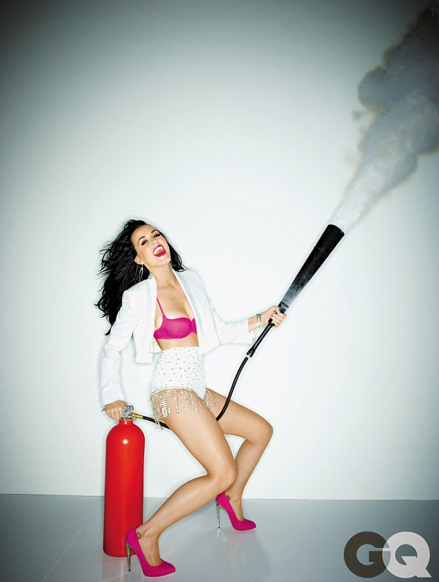 Explosive: The 29-year-old sat astride a fire extinguisher in one revealing shot