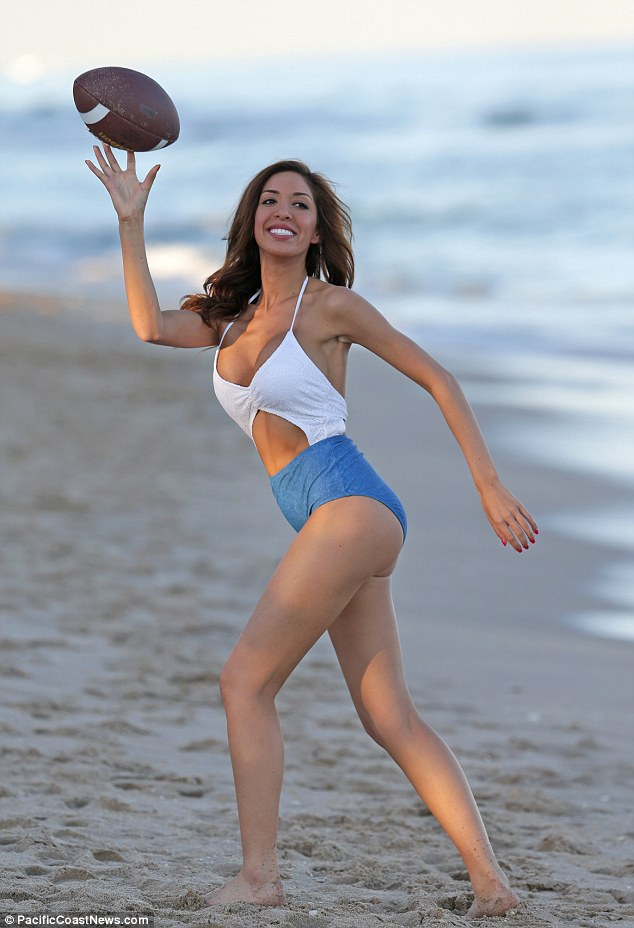 Nice catch! Farrah Abraham plays football while enjoying a day at the beach on Monday in Miami
