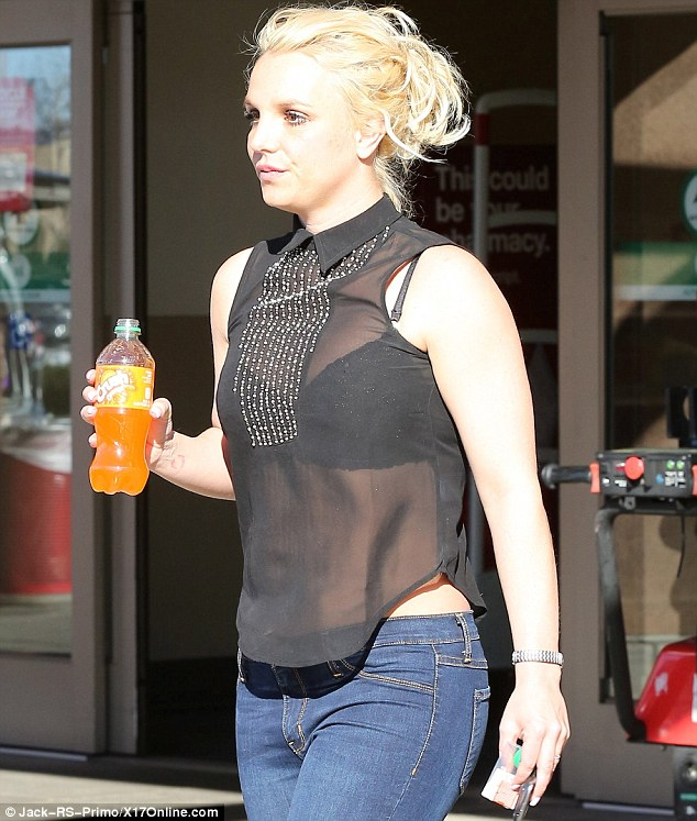 Not counting calories: The Womanizer singer did not seem too concerned about her figure as she gripped on to an orange soda