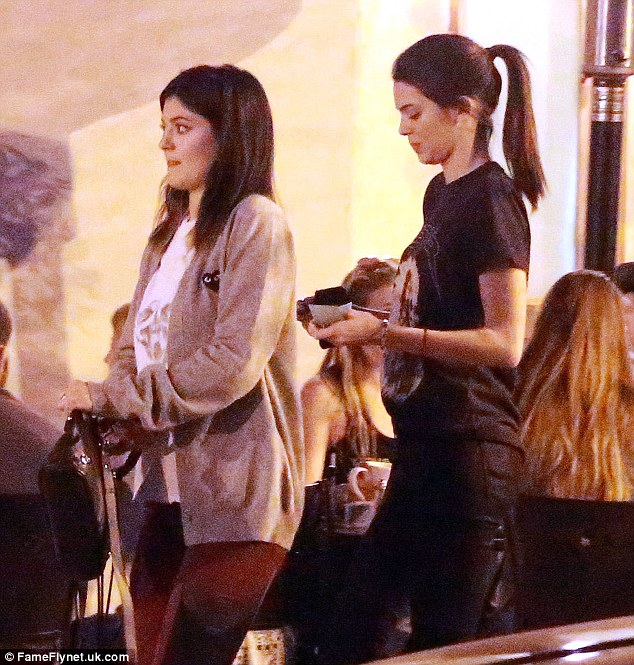 Here come the girl: Kylie, 16, and Kendall, 18, were at an organic restaurant with their friend