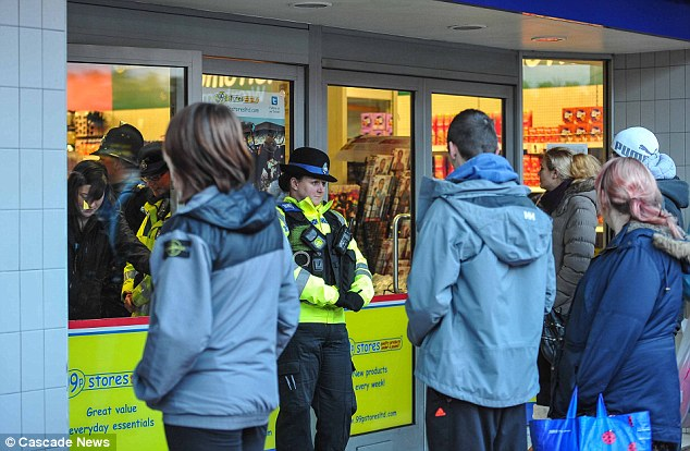 No entry: Police were called to calm shoppers at the 99p Store in Wrexham after its 50p sale was cancelled