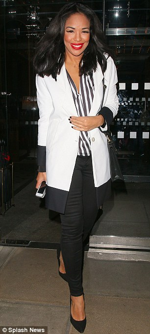 Monochrome: Sarah-Jane Crawford opted for a white blazer and striped blouse