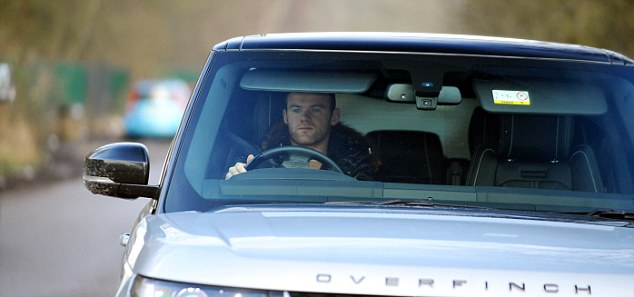 Stylish: The United talisman rolled into training in his Range Rover Overfinch 4x4 on Tuesday morning