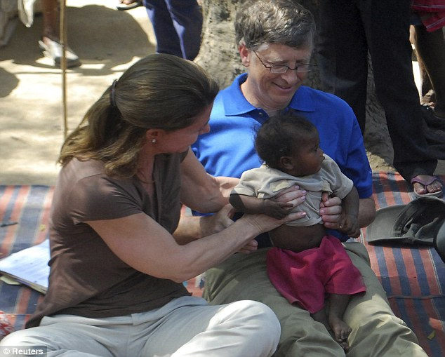 Microsoft Corp co-founder Bill Gates and his wife Melinda hold a child during their visit to a Danapur slum area near the eastern Indian city of Patna in 2011 with the Bill & Melinda Gates Foundation
