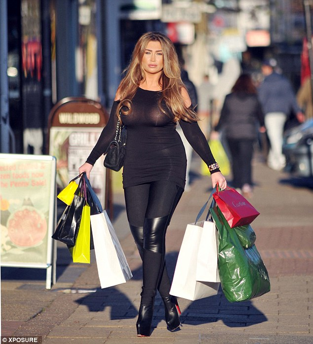 Quite the haul: Lauren carried a number of bags from Selfridges and Harrods