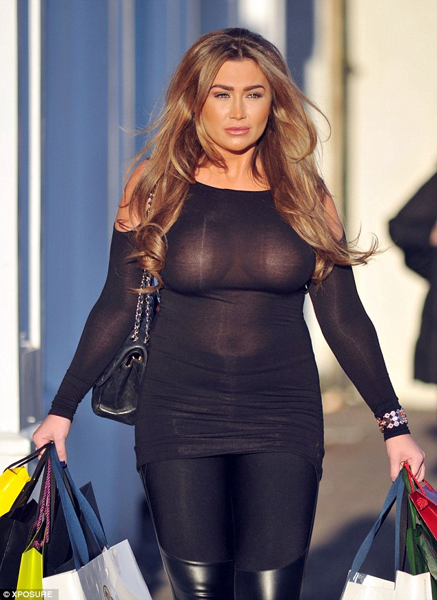 Forget something? Lauren Goodger goes without a bra during shopping trip in London