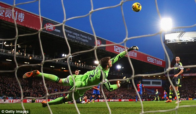 Battle: Jack Butland makes a save against Crystal Palace on Saturday but Stoke went down 1-0