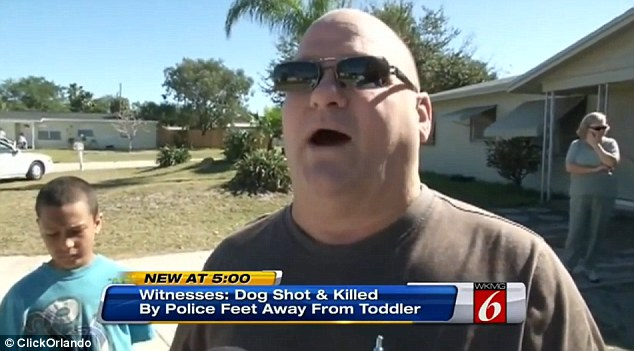Appalled: This man was upset that he had witnessed the shooting - especially when the dog's owner was 15-feet away from the deputy at the time