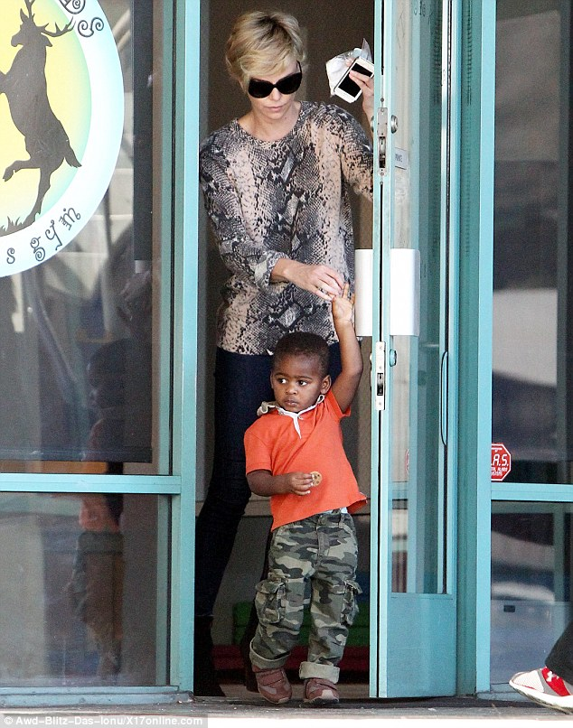 Main man: The Monster actress with her son Jackson, aged two, in LA on January 13