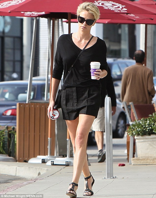 Quick breakfast: The leggy lady picked up a drink and a yogurt at the Coffee Bean & Tea Leaf in West Hollywood on Tuesday