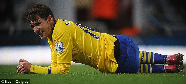 Sidelined: Ramsey hasn't featured since the win at West Ham on Boxing Day
