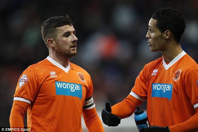 Talking it over: Blackpool's Tom Ince, right, speaks to club captain Barry Ferguson, who it is understood will take charge of the team until the end of the season