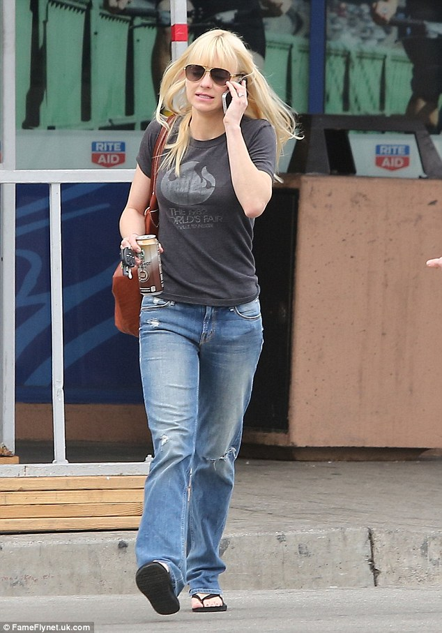 Multitasking: The Mom star was later seen chatting away on her cell phone while holding a caffeinated beverage in her hand