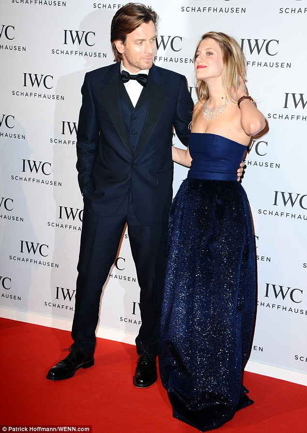 Cute couple: Actor Ewan McGregor looked every inch the dapper dude in a navy blue three-piece suit as he posed with an elegant Melanie Laurents
