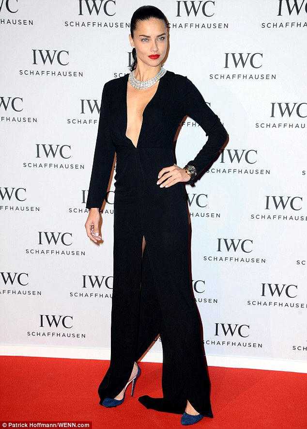 Supermodel strut: The Brazilian bombshell completed her red carpet look with a pair of navy blue killer heels and of course, an envy-inducing watch