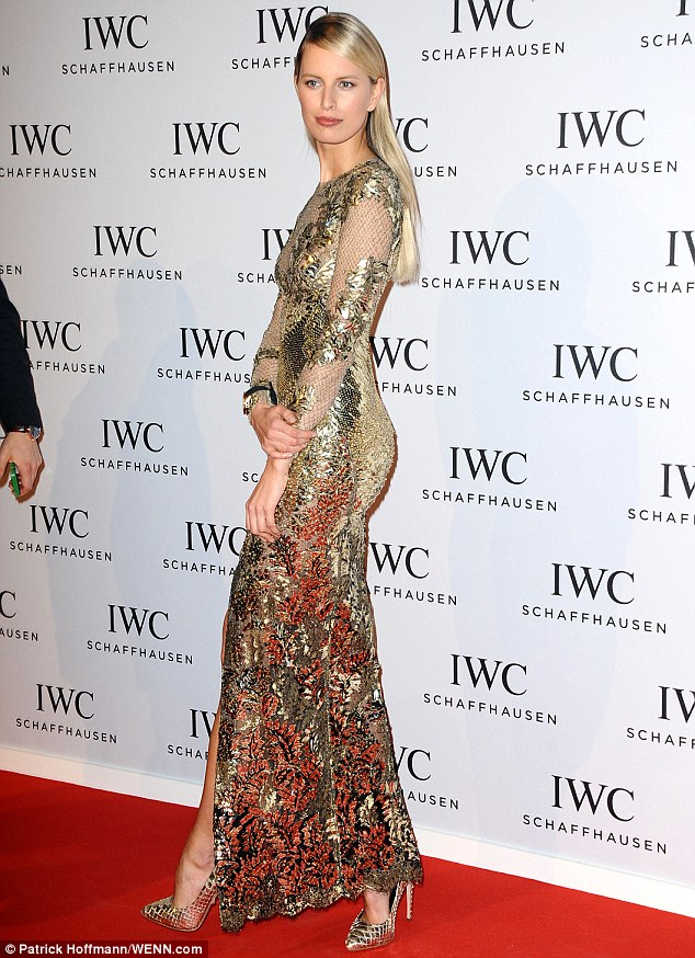Sheer daring: Karolina also opted for a plunging, thigh-split gown for the star-studded occasion, commanding attention in a glittering gold sequin number
