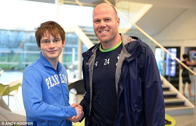 All smiles: Tottenham keeper Brad Friedel greets Sportsmail's Dan Ripley ahead of a training session