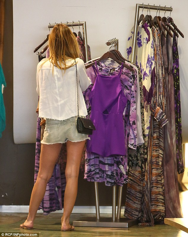 Retail therapy: She browsed through selections of clothing at Planet Blue, a boutique specializing in bohemian beach culture style