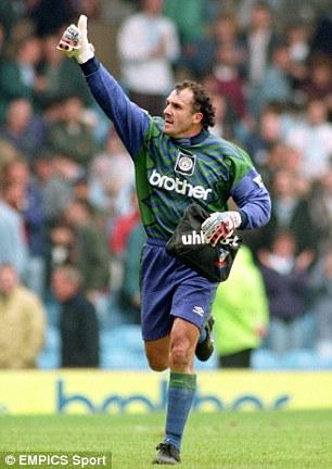 Veteran: Burridge salutes the Manchester City fans during a Premier League match during the 1994/95 campaign