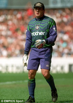 Hats off to you: John Burridge stands in goal for Manchester City during a game against Nottingham Forest in 1995