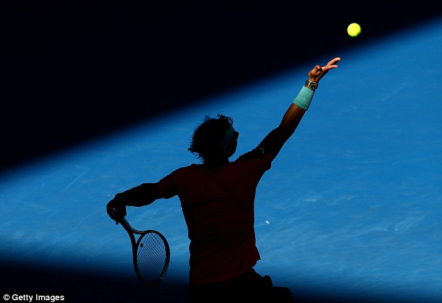 Lurking in the shadows: Federer will play great rival Rafael Nadal in the semi-finals