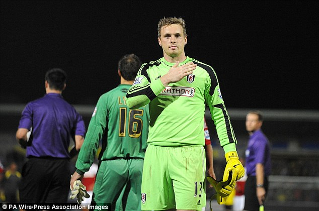 Safe hands: David Stockdale celebrates with the Fulham fans after winning in the League Cup