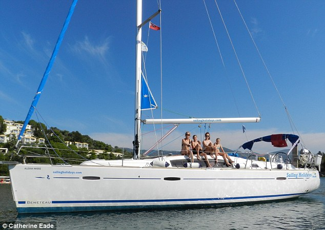 'Alexia': Catherine and family moor in a cove for a swim before lunch in the sunshine. The Beneteau 40 which is their home for the week is modern and comfortable, as well as easy to sail